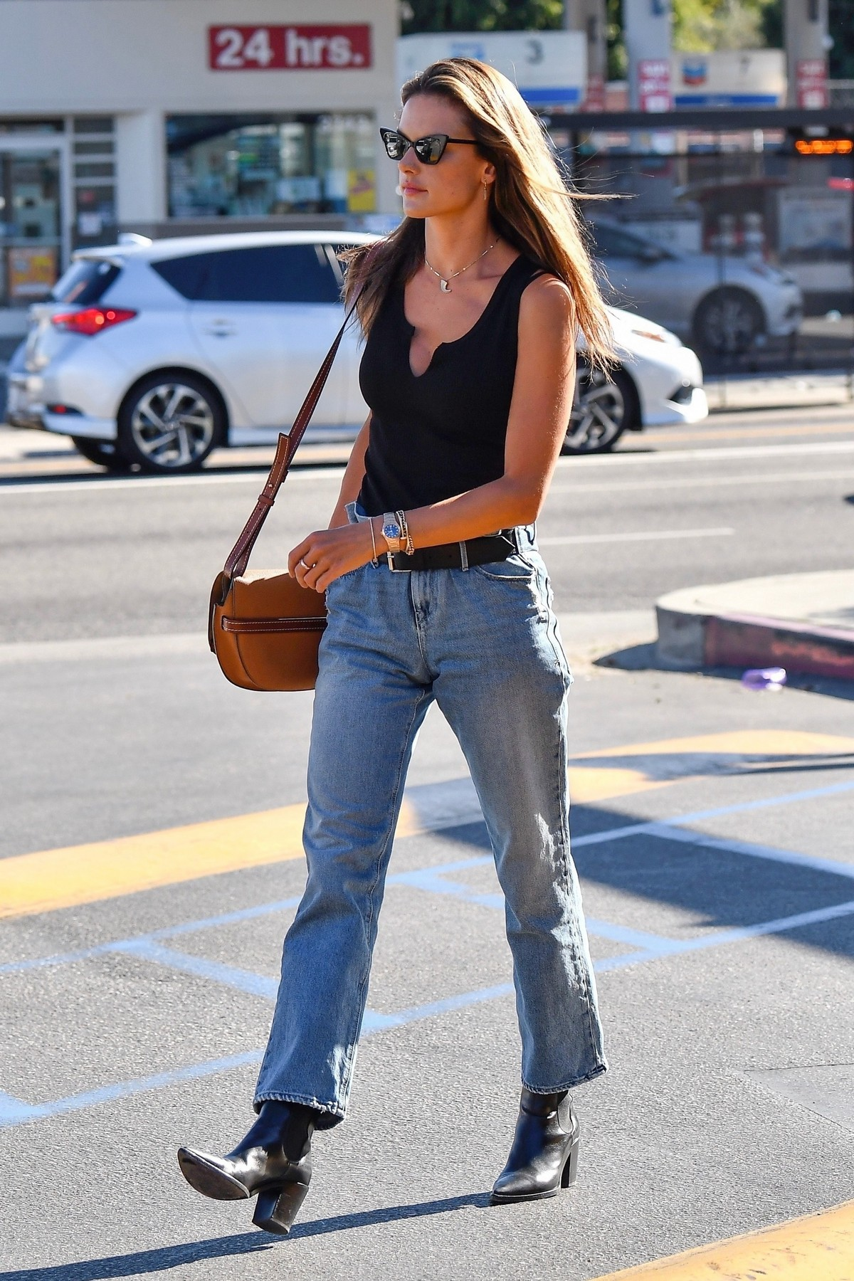 Alessandra Ambrosio in Black Top and Blue Jeans out in Los Angeles 2019/11/18 28
