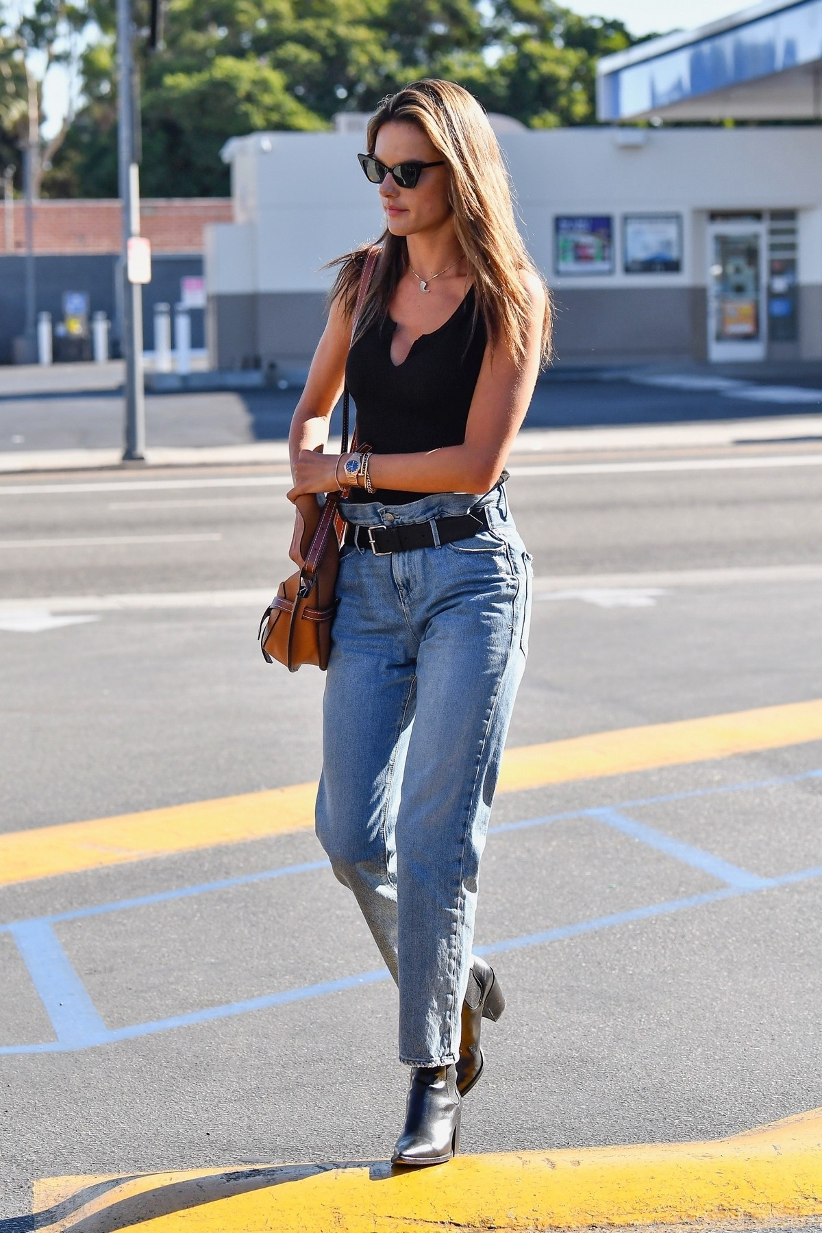 Alessandra Ambrosio in Black Top and Blue Jeans out in Los Angeles 2019/11/18 30