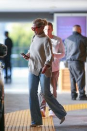 Cameron Diaz in high neck top and blue denim out at Eataly in Los Angeles 2019/11/21 2