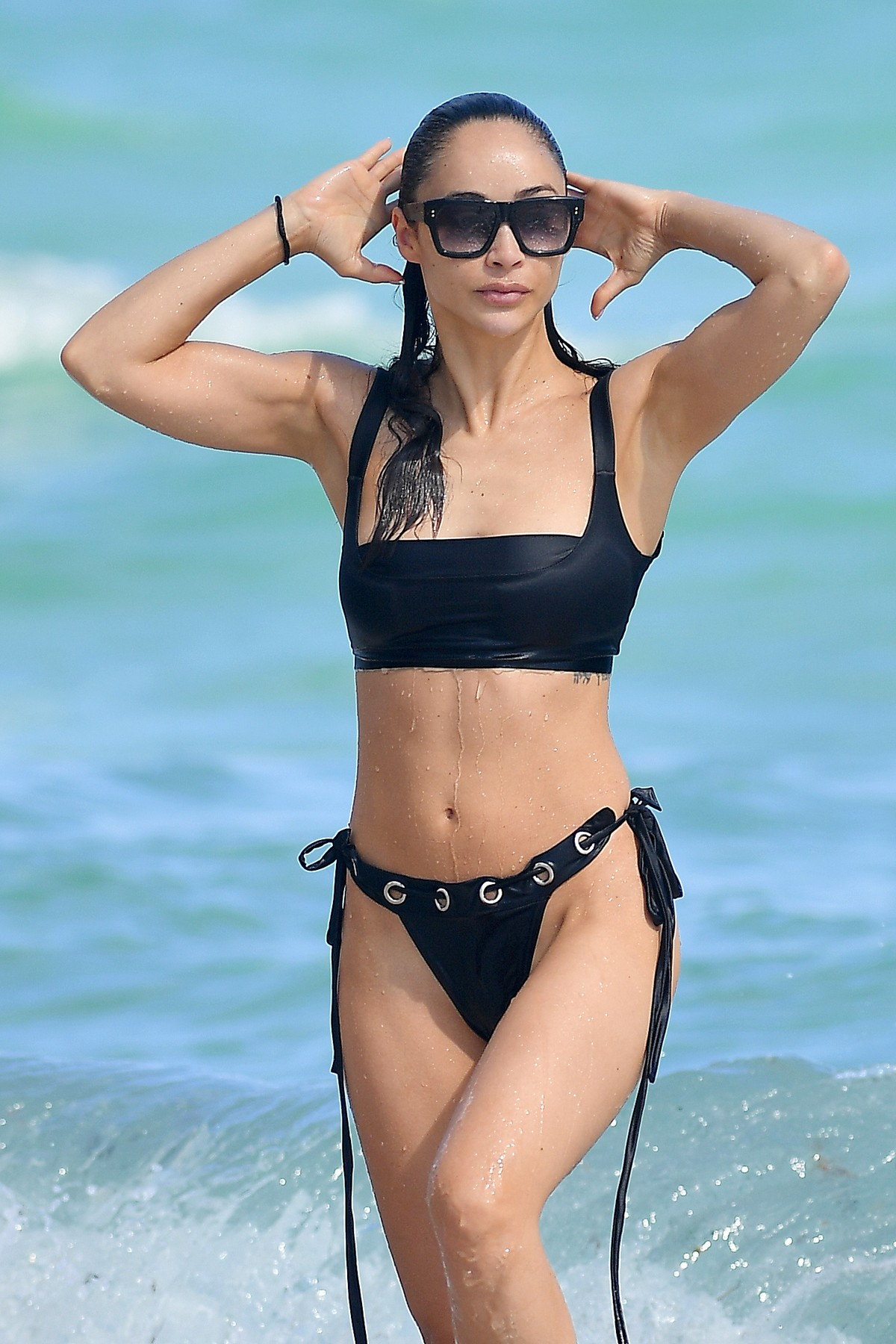 Cara Santana wears a black bikini in Miami Beach, Florida 2019/11/07 16