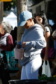 Christina Milian in grey hoddie with tights at her Beinet Box Truck in Los Angeles 2019/11/24 6