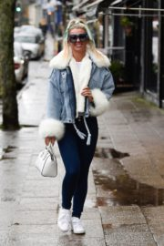 Christine McGuinness in white cozy teddy jacket and tights out in Alderley Edge Cheshire, England 2019/11/28 15