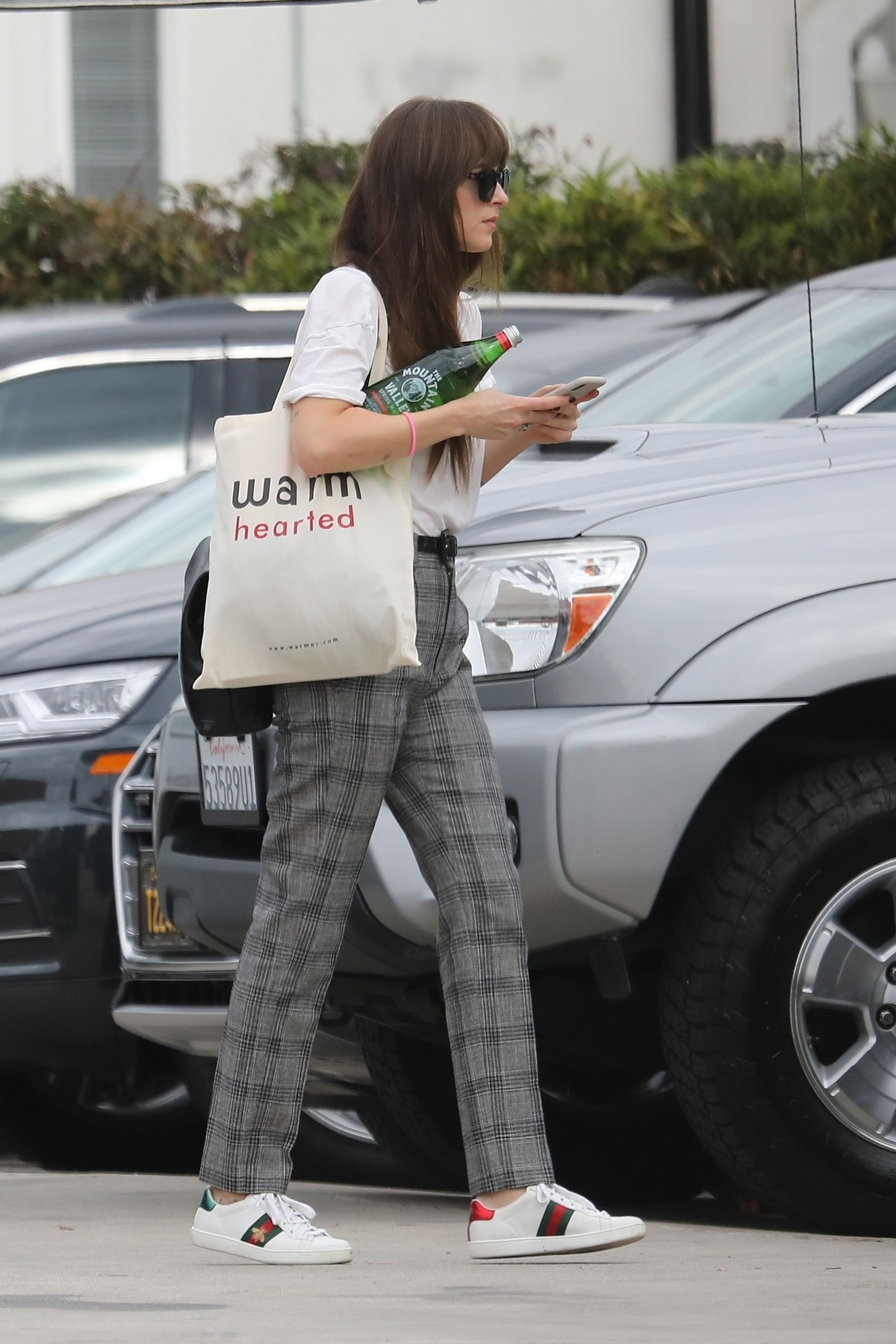 Dakota Johnson in White Loose Top and Check Pants Out in Santa Monica 2019/11/19 1