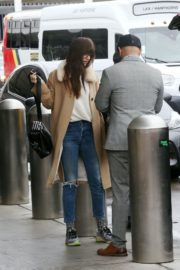 Dakota Johnson in white top and ripped jeans with long coat out in Los Angeles 2019/11/27 4