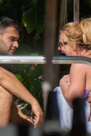 Britney Spears in Bikini with her boyfriend Sam Asghari enjoy sunbathing poolside in Miami 2019/12/01 1