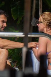 Britney Spears in Bikini with her boyfriend Sam Asghari enjoy sunbathing poolside in Miami 2019/12/01 8