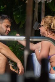 Britney Spears in Bikini with her boyfriend Sam Asghari enjoy sunbathing poolside in Miami 2019/12/01 14