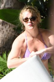 Britney Spears in Bikini with her boyfriend Sam Asghari enjoy sunbathing poolside in Miami 2019/12/01 15