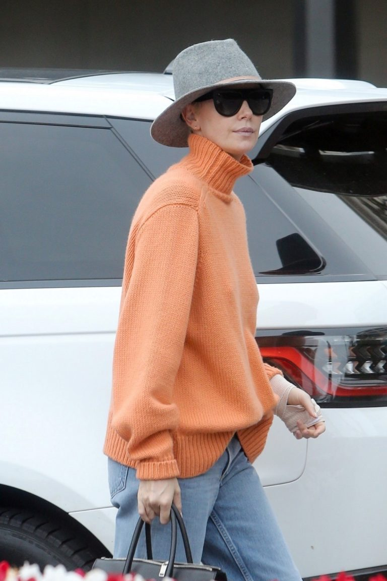 Charlize Theron in high neck sweater and blue denim out in Los Angeles 2019/11/30 1