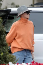 Charlize Theron in high neck sweater and blue denim out in Los Angeles 2019/11/30 5