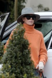 Charlize Theron in high neck sweater and blue denim out in Los Angeles 2019/11/30 6