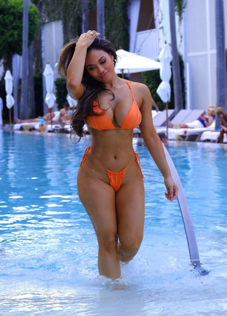Daphne Joy in orange bikini with friend at the pool during Art Basel in Miami 2019/12/09 7