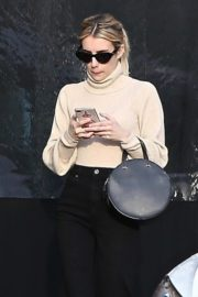 Emma Roberts seen high neck top with black jeans shopping out in Los Angeles 2019/12/08 2