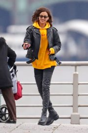 Irina Shayk poses in yellow top with leather jacket out in New York City 2019/11/27 12