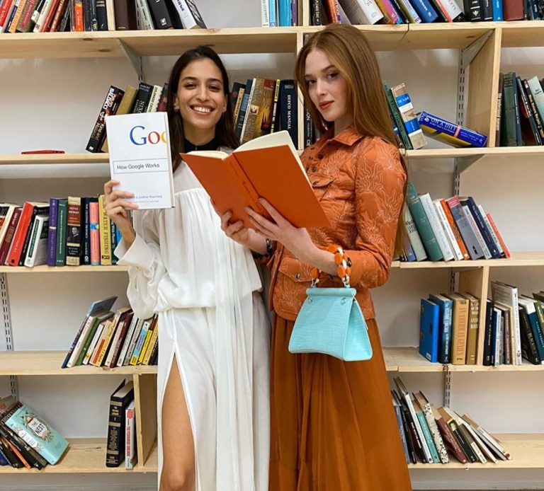 Larsen Thompson covers up in brick color outfit while matching the book with her dress at Art Basel Miami Beach 2019 1