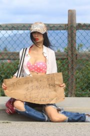 Bai Ling seen in pink dotted bra and ripped jeans during Coronavirus 2020/03/25 2