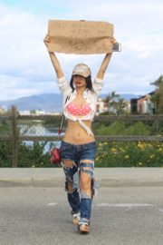 Bai Ling seen in pink dotted bra and ripped jeans during Coronavirus 2020/03/25 10