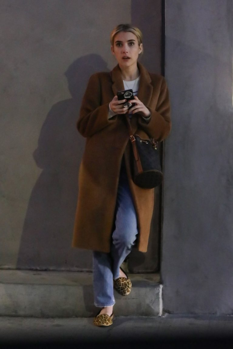 Emma Roberts in long brown coat with blue denim out in Los Angeles, California 2020/03/04 1