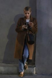 Emma Roberts in long brown coat with blue denim out in Los Angeles, California 2020/03/04 2