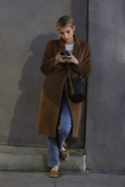 Emma Roberts in long brown coat with blue denim out in Los Angeles, California 2020/03/04 3