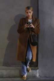 Emma Roberts in long brown coat with blue denim out in Los Angeles, California 2020/03/04 6