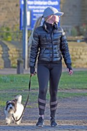 Jorgie Porter in puffer jacket and tights during jogging with her dog in Manchester 2020/03/29 1