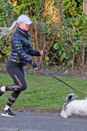 Jorgie Porter in puffer jacket and tights during jogging with her dog in Manchester 2020/03/29 2
