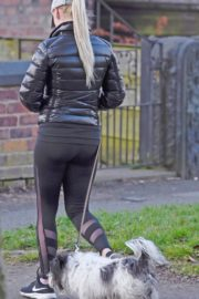 Jorgie Porter in puffer jacket and tights during jogging with her dog in Manchester 2020/03/29 3