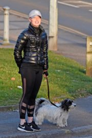 Jorgie Porter in puffer jacket and tights during jogging with her dog in Manchester 2020/03/29 4