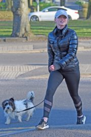 Jorgie Porter in puffer jacket and tights during jogging with her dog in Manchester 2020/03/29 5