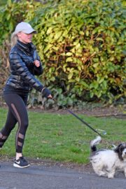 Jorgie Porter in puffer jacket and tights during jogging with her dog in Manchester 2020/03/29 6