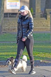 Jorgie Porter in puffer jacket and tights during jogging with her dog in Manchester 2020/03/29 7