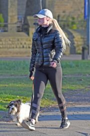 Jorgie Porter in puffer jacket and tights during jogging with her dog in Manchester 2020/03/29 8