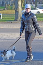 Jorgie Porter in puffer jacket and tights during jogging with her dog in Manchester 2020/03/29 9