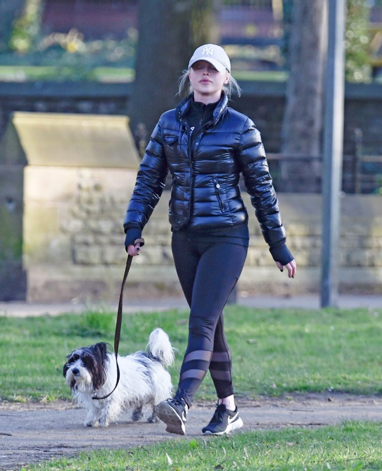 Jorgie Porter in puffer jacket and tights during jogging with her dog in Manchester 2020/03/29 12