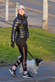 Jorgie Porter in puffer jacket and tights during jogging with her dog in Manchester 2020/03/29 14
