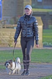 Jorgie Porter in puffer jacket and tights during jogging with her dog in Manchester 2020/03/29 15