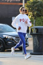 Nina Dobrev seen in white hoodie with tights during jogging in Los Angeles 2020/03/26 6