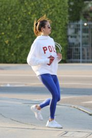 Nina Dobrev seen in white hoodie with tights during jogging in Los Angeles 2020/03/26 7