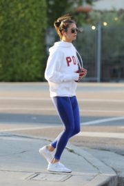 Nina Dobrev seen in white hoodie with tights during jogging in Los Angeles 2020/03/26 10