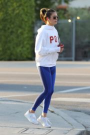 Nina Dobrev seen in white hoodie with tights during jogging in Los Angeles 2020/03/26 11