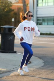 Nina Dobrev seen in white hoodie with tights during jogging in Los Angeles 2020/03/26 13