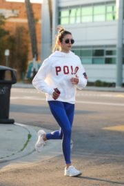 Nina Dobrev seen in white hoodie with tights during jogging in Los Angeles 2020/03/26 14
