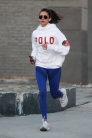 Nina Dobrev seen in white hoodie with tights during jogging in Los Angeles 2020/03/26 16