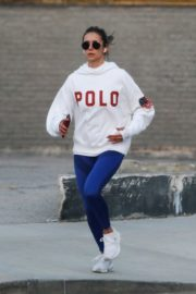 Nina Dobrev seen in white hoodie with tights during jogging in Los Angeles 2020/03/26 17