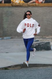 Nina Dobrev seen in white hoodie with tights during jogging in Los Angeles 2020/03/26 18
