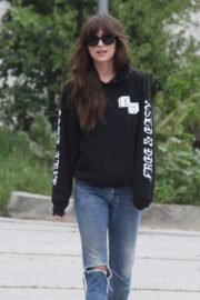 Dakota Johnson seen in black sweatshirt and ankle jeans out in Los Angeles 2020/04/13 2