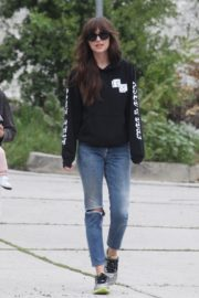 Dakota Johnson seen in black sweatshirt and ankle jeans out in Los Angeles 2020/04/13 3