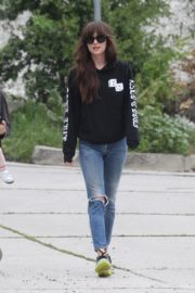 Dakota Johnson seen in black sweatshirt and ankle jeans out in Los Angeles 2020/04/13 13