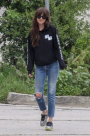 Dakota Johnson seen in black sweatshirt and ankle jeans out in Los Angeles 2020/04/13 14